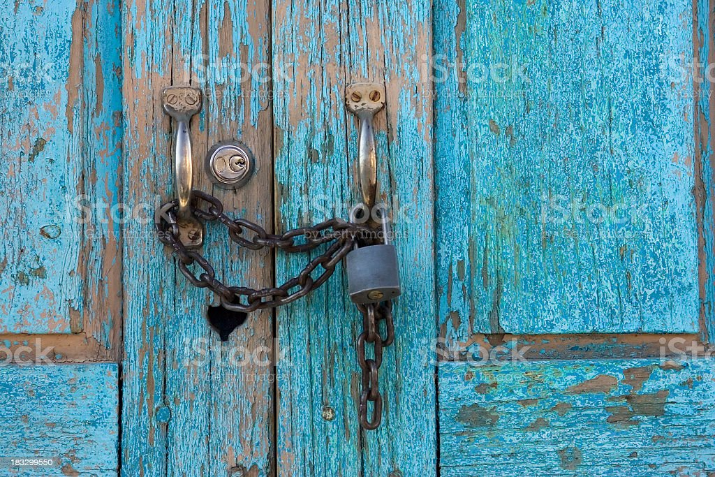 Old Wooden Door with Lock & Chain stock photo