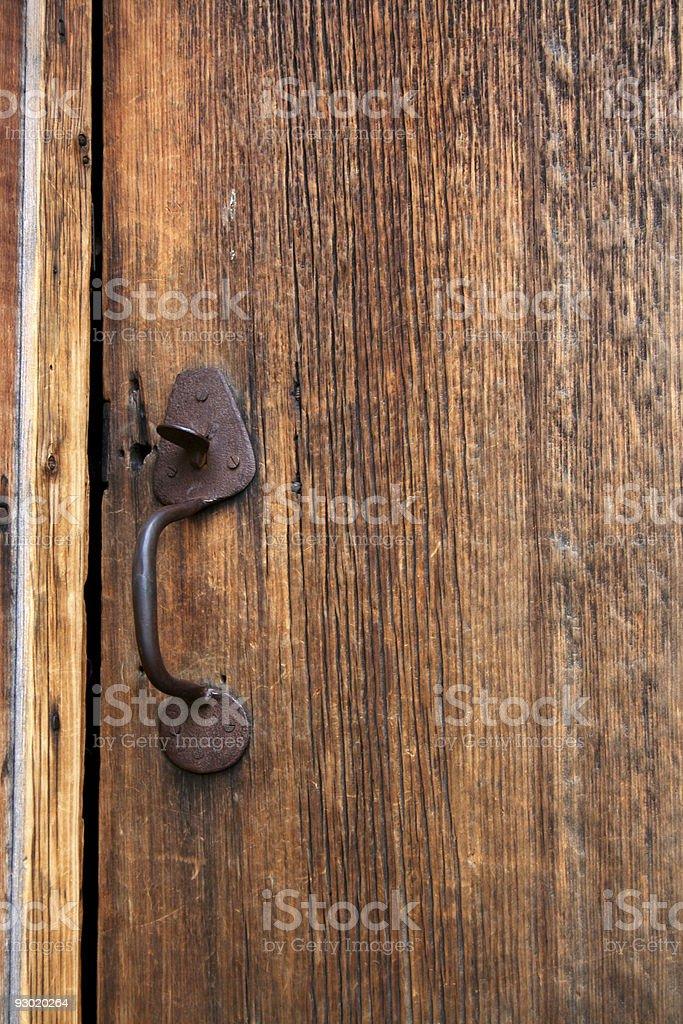 Old wooden door with metal handle. stock photo