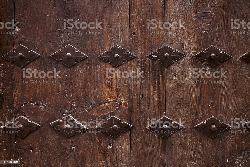 old wooden door with metal ornate background royalty-free stock photo