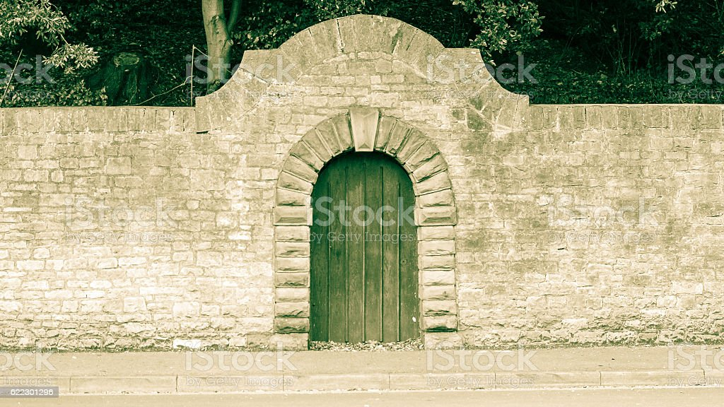 Old Wooden Door with Stone Round Arch stock photo