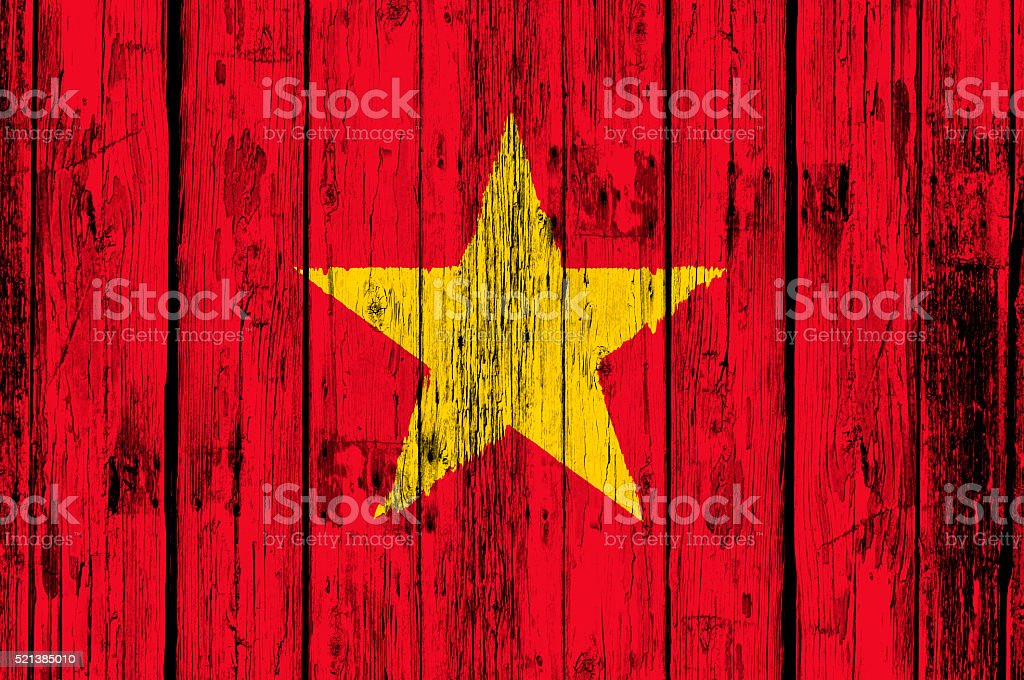 Old wooden door with Vietamese Flag stock photo