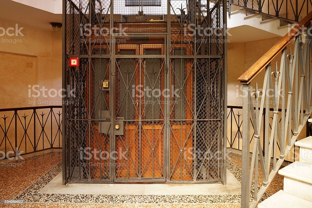 Old Wooden Elevator in a Metal Shaft stock photo