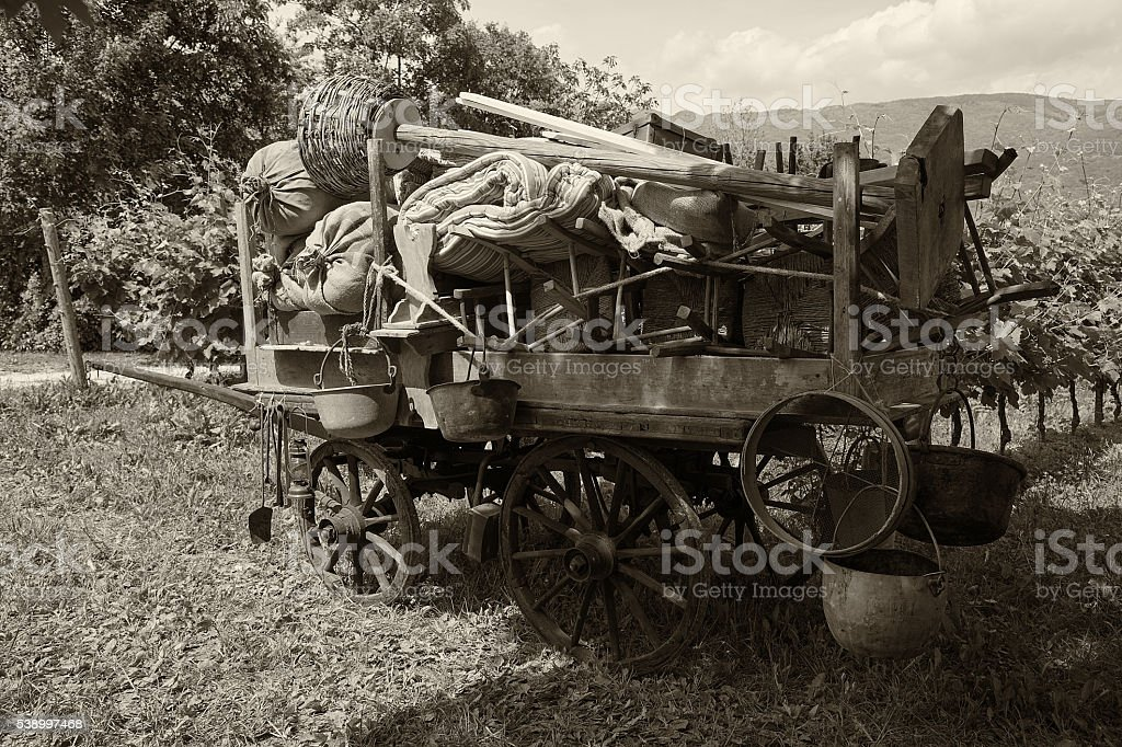 Old wooden farm Wagon - vintage style stock photo