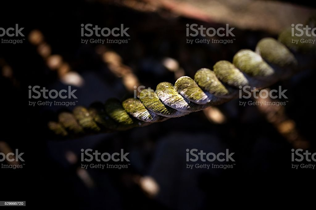 Old Wooden fence and rope on black background stock photo