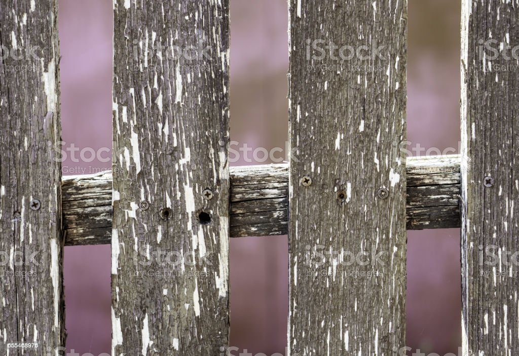 Old wooden fence on rose abstract background stock photo