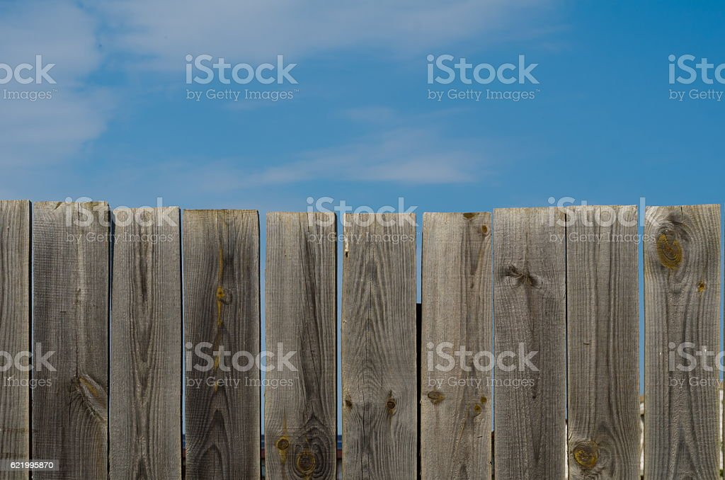 old wooden fence with gate on sky background stock photo