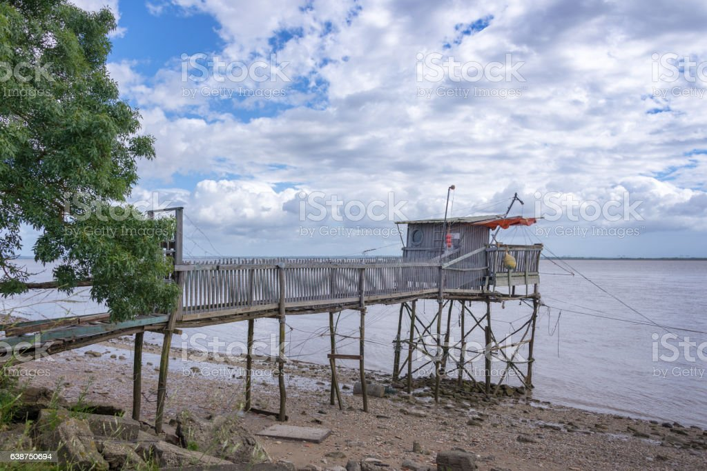 Old wooden fisher cabin on Gironde estuary, France stock photo