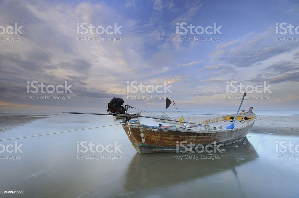 Old Wooden Fishing Boat in Thailand stock photo