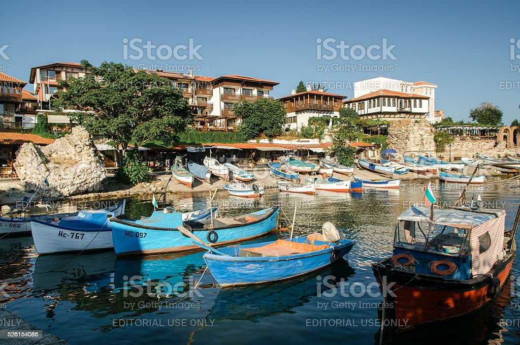 Old wooden fishing boats in port of Old Nesebar stock photo