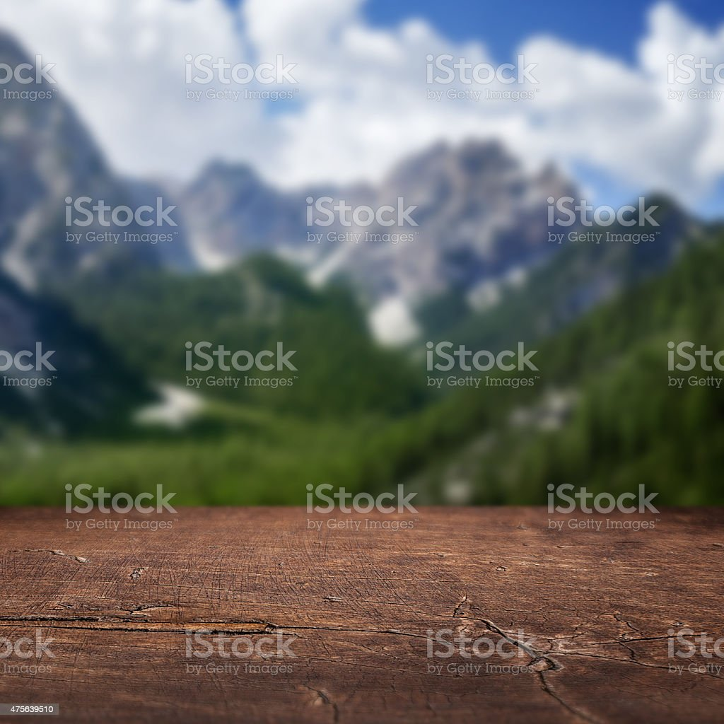 Old wooden floor and mountains on background. stock photo