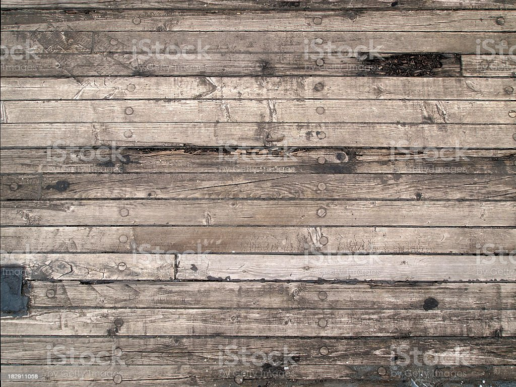 Old wooden floor of the sailing boat, with scratches, cracks stock photo