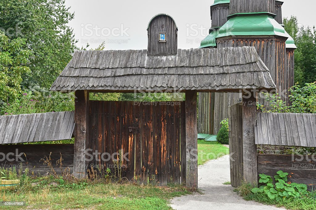Old wooden gate with a wooden roof royalty-free stock photo