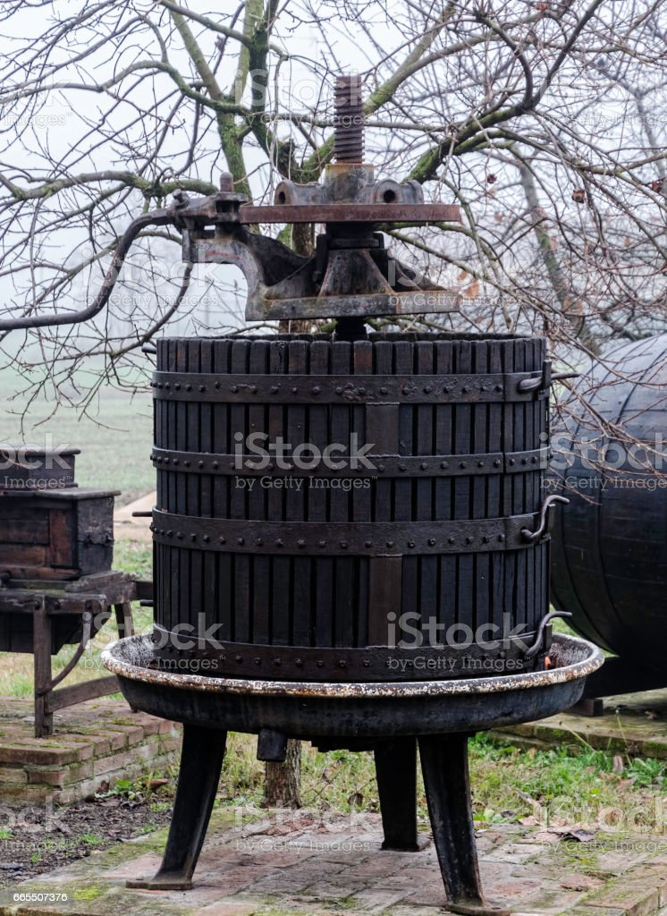 Old wooden grape mechanical press stock photo