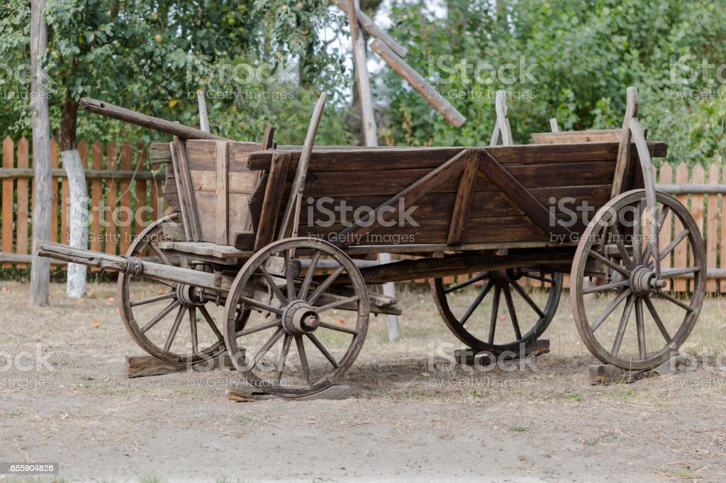 Old wooden horsedrawn on farm stock photo