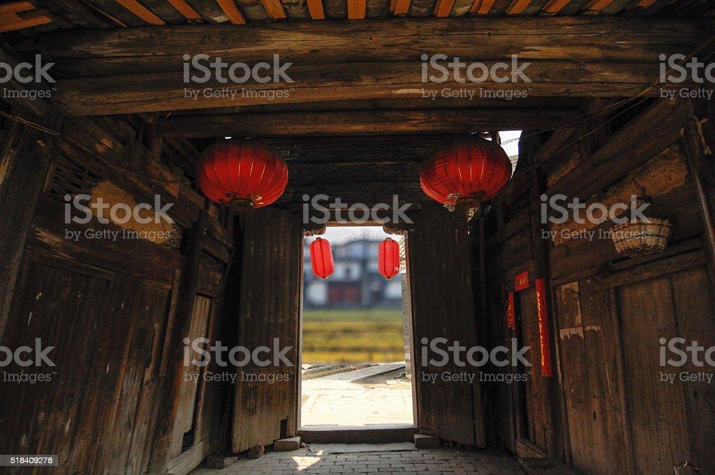 old wooden house, door open to the rural field stock photo