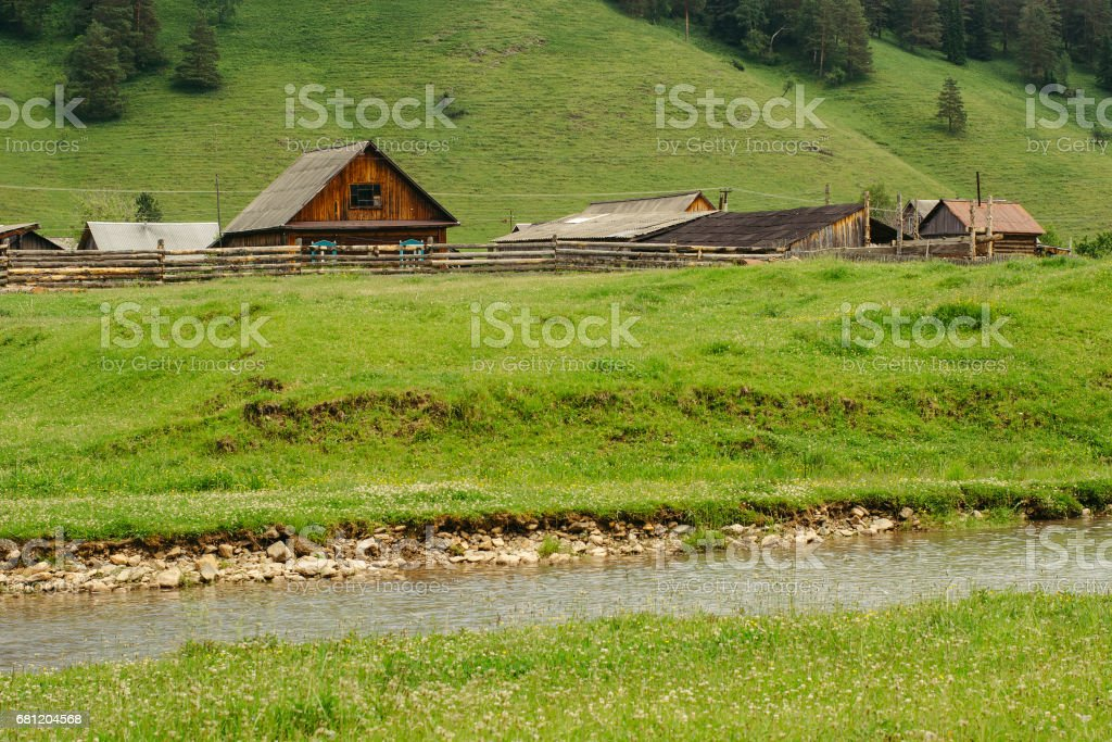 Old wooden houses in the hills and rivers. Altai. stock photo