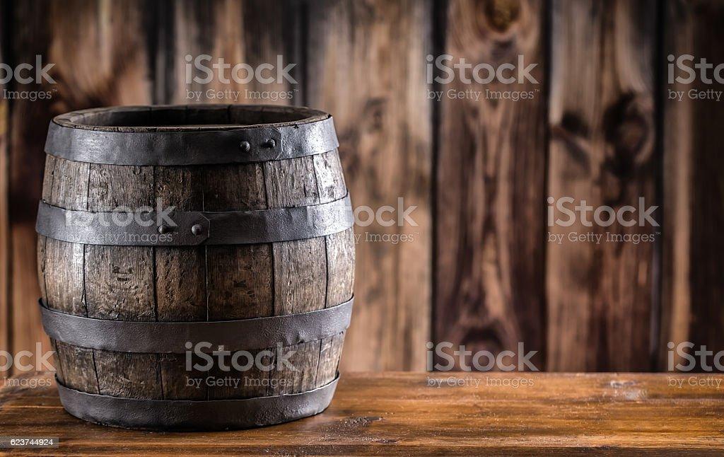 Old wooden keg. Barrel on beer vine whiskey brandy cognac. stock photo
