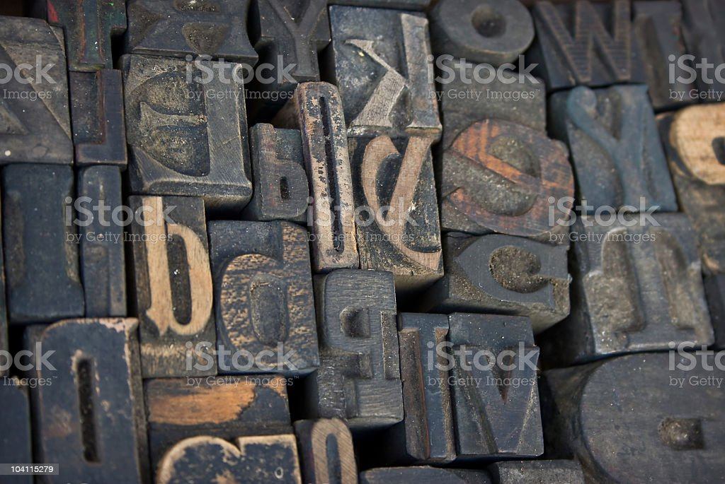 Old wooden letterpress characters from a printing press stock photo