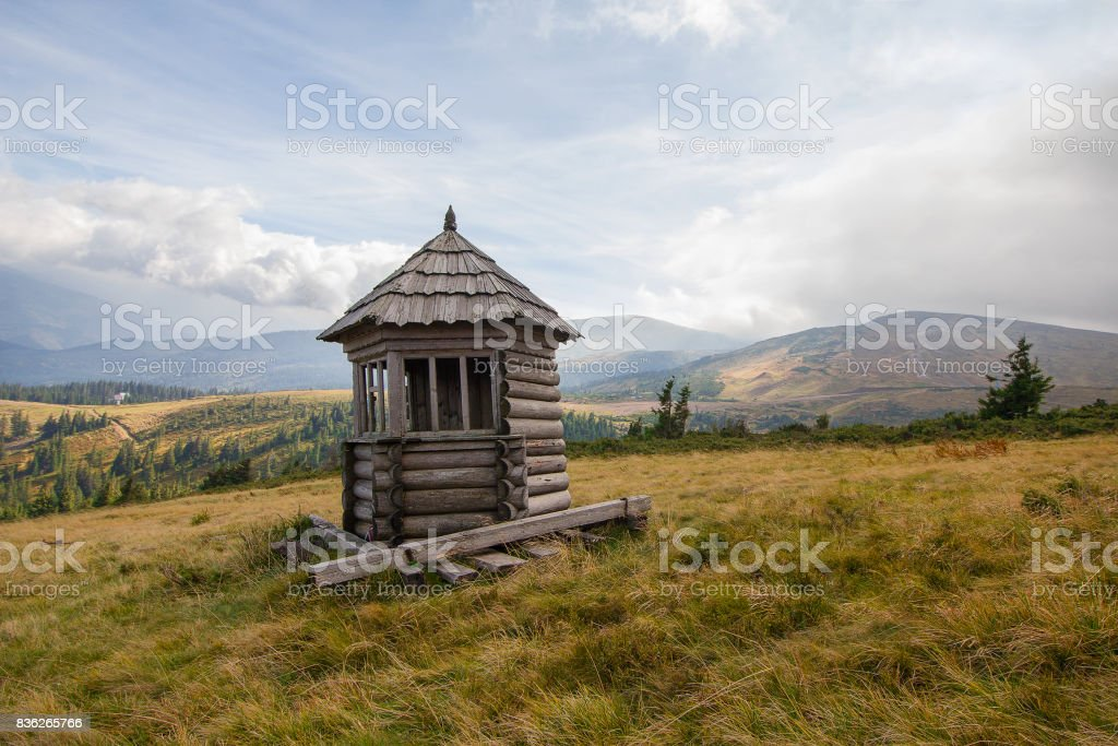Old wooden lodge in the background of the mountains. Carpathians stock photo