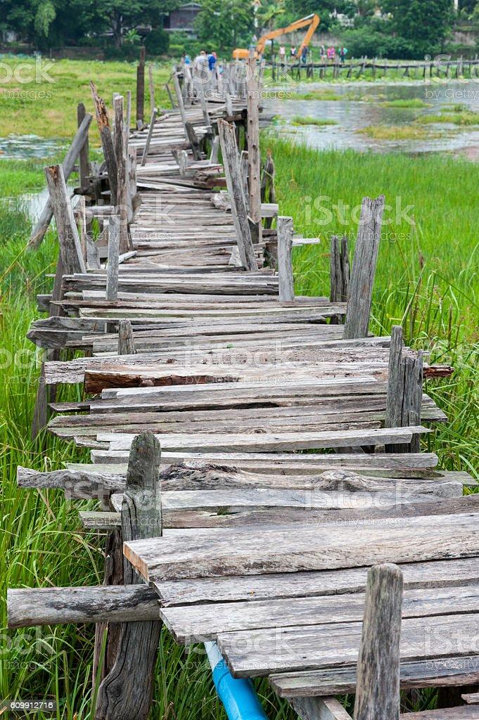 Old wooden  long  bridge. stock photo