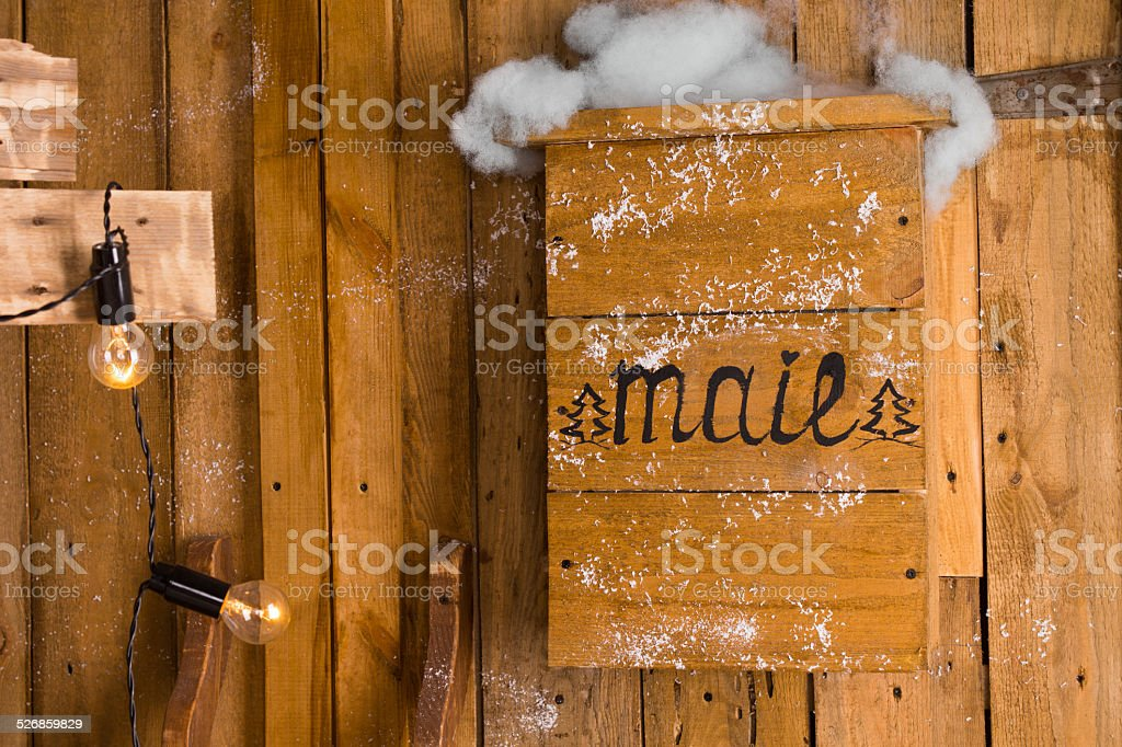 Old wooden mailbox in a snowy day of winter stock photo