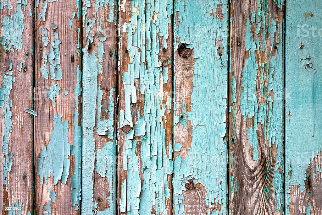 Old wooden painted light blue rustic fence, paint peeling background stock photo