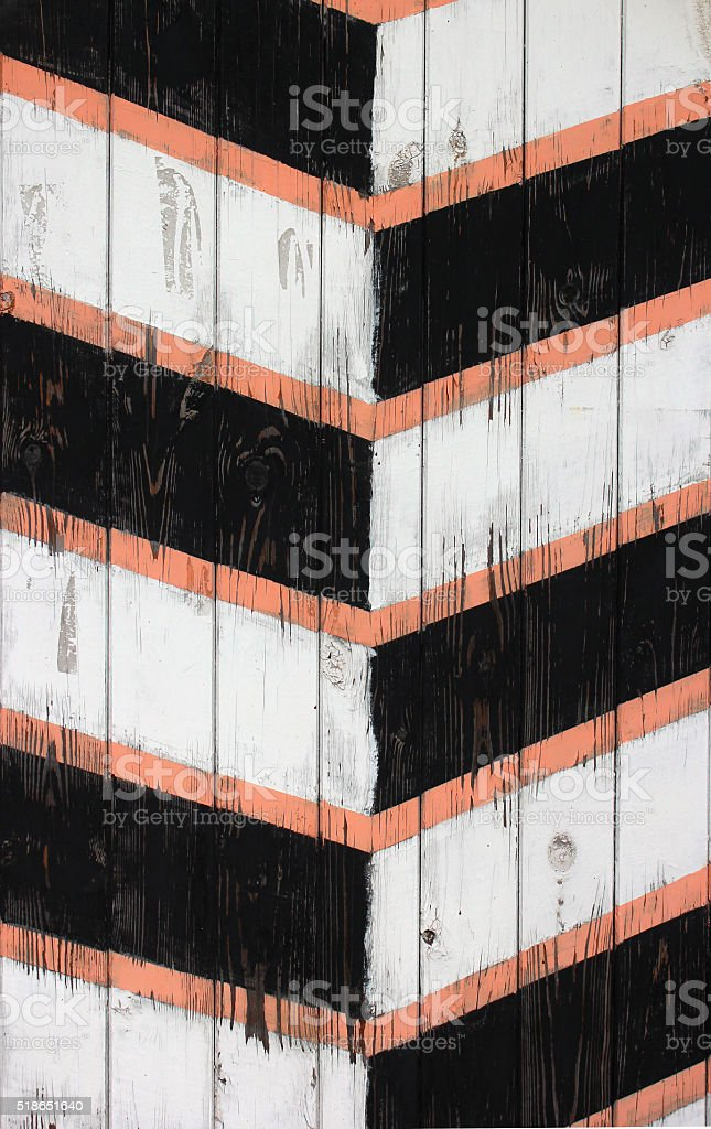 old wooden painted striped guard post texture. stock photo