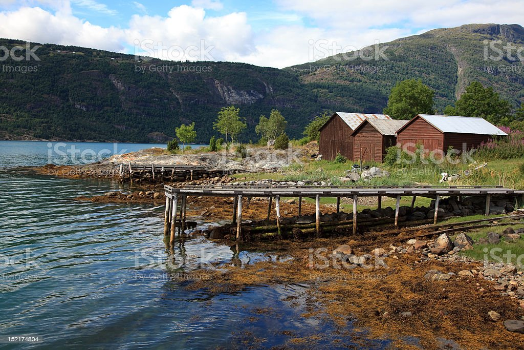 Old wooden pier and the boathouses royalty-free stock photo
