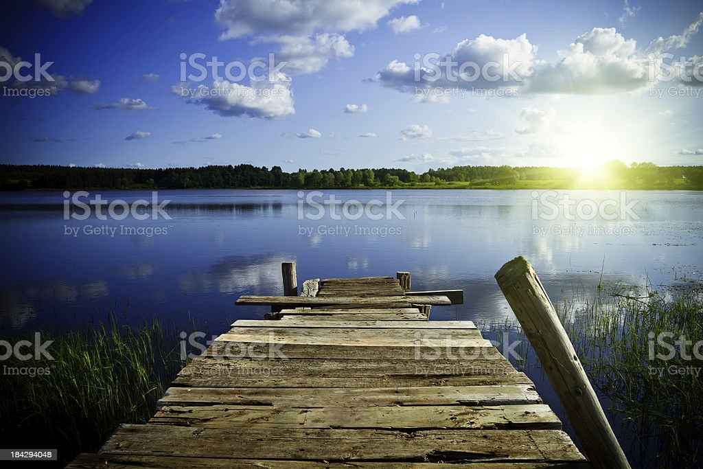 Old wooden pier at sunrise royalty-free stock photo