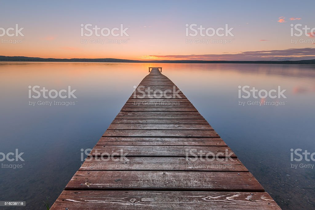 Old wooden pier on sunset stock photo