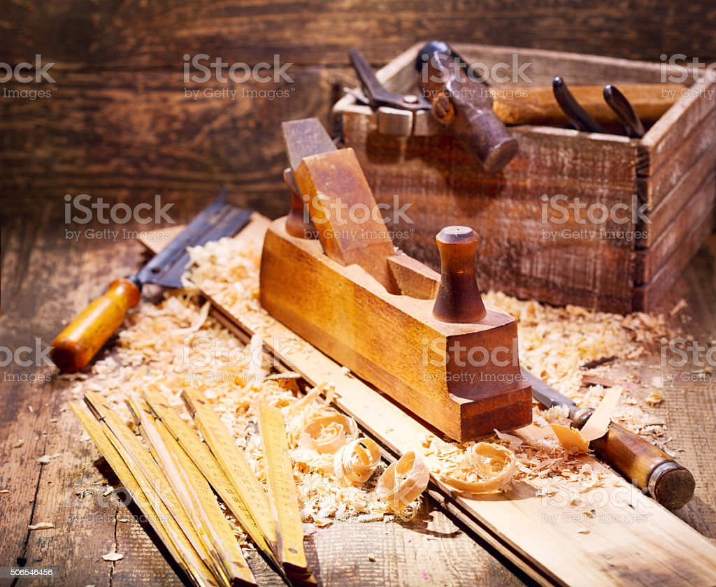 old wooden plane in a workshop stock photo