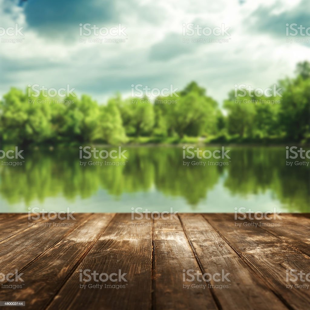 Old wooden planks and defocused forest landscape on background stock photo
