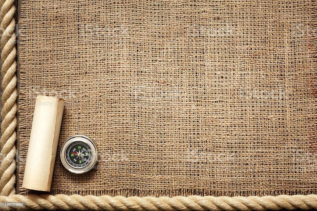 Old wooden planks and rope with compass royalty-free stock photo