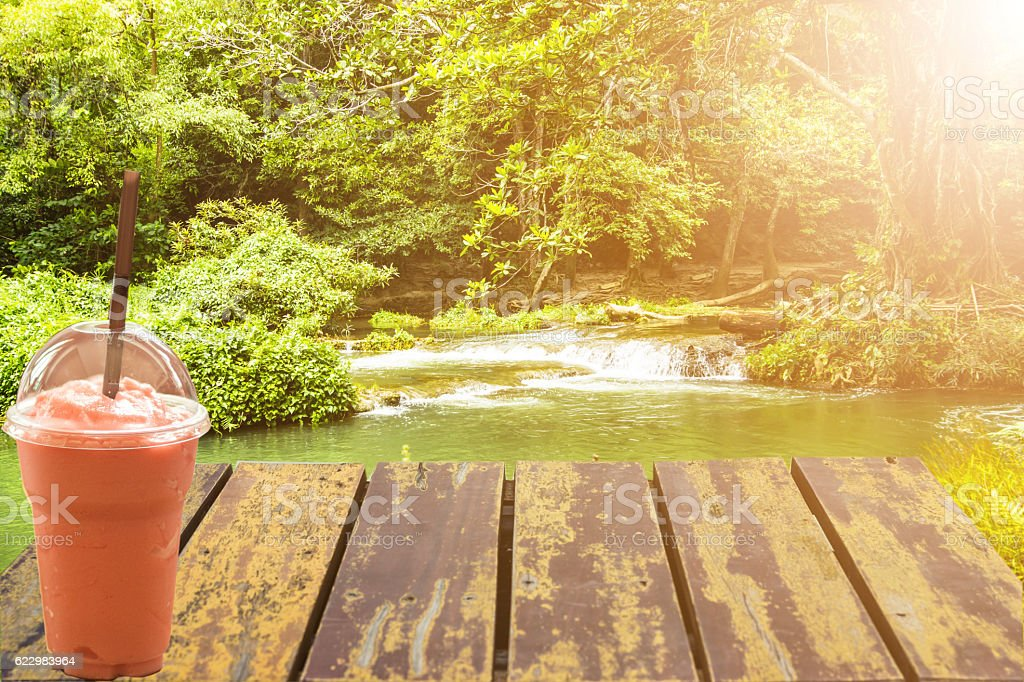 Old wooden porch standing in a waterfall. stock photo