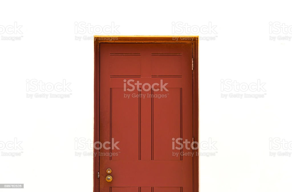 Old wooden red door against white background with copy space stock photo