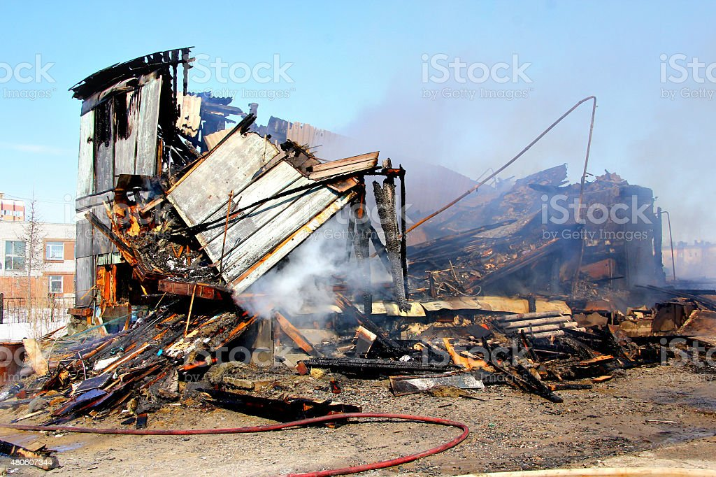 Old wooden residential house after a fire stock photo
