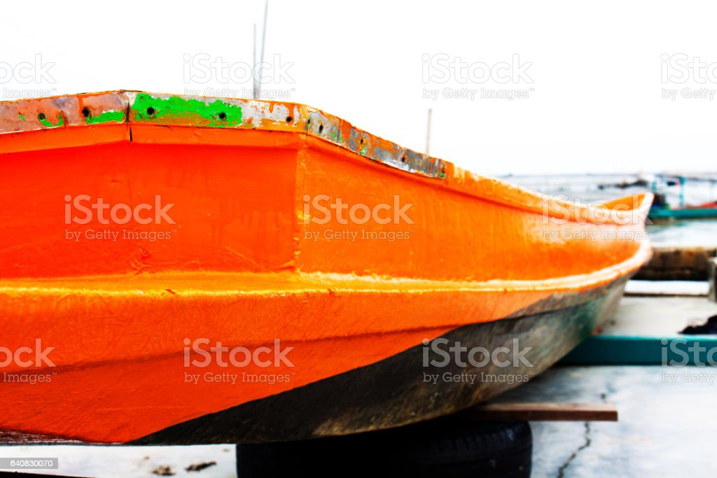 old wooden row boat stock photo
