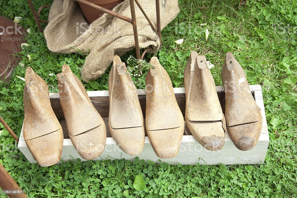 Old wooden shoe lasts stock photo