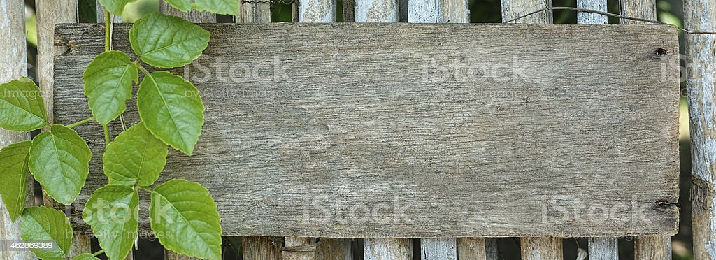 Old wooden signboard on a garden fence. royalty-free stock photo