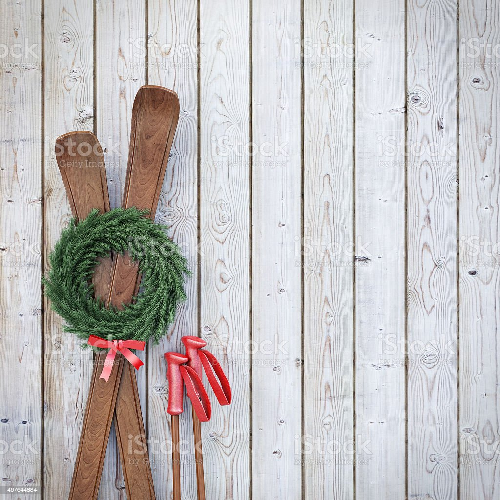 old wooden skis on wooden planks wall with garland stock photo