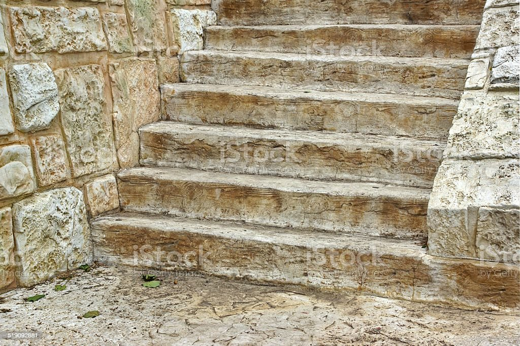 Old Wooden Staircase and stone wall stock photo
