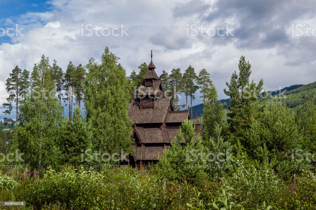 Old wooden stave church in Norway stock photo