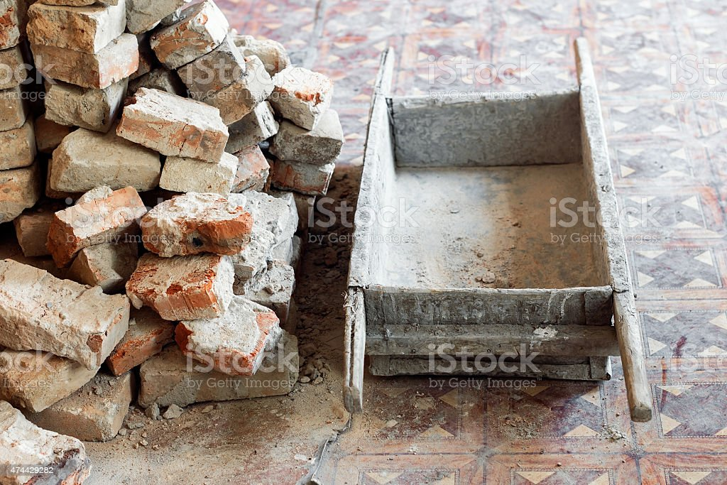 Old wooden stretcher and bricks stock photo