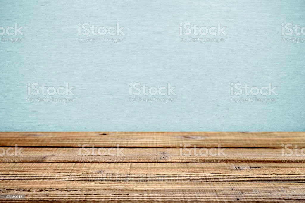 Old wooden table near wall. Shallow depth of field stock photo