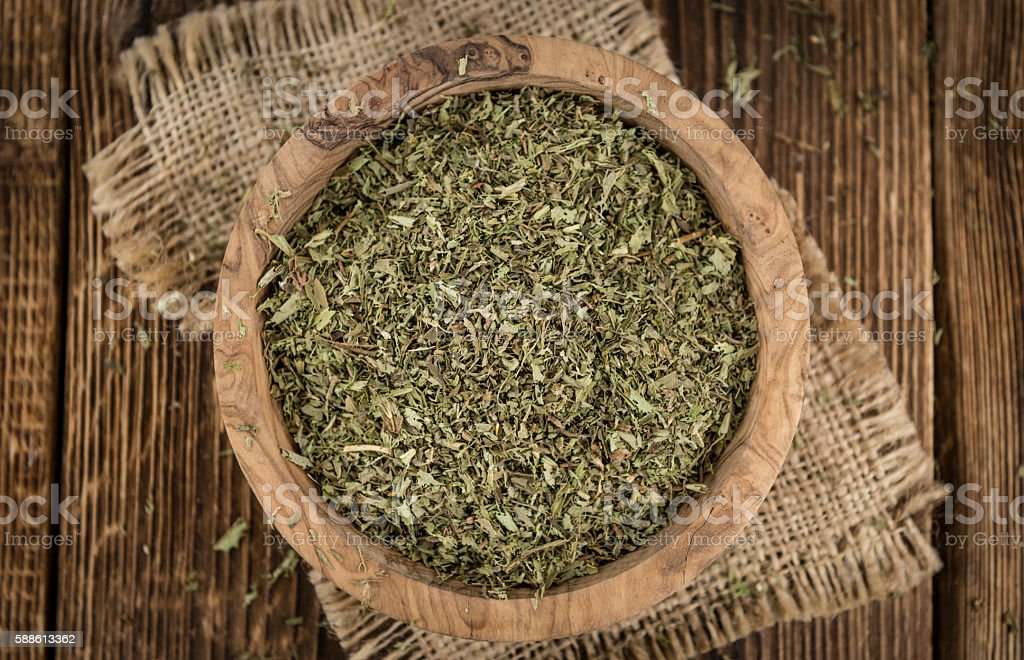 Old wooden table with dried Stevia leaves (selective focus) stock photo