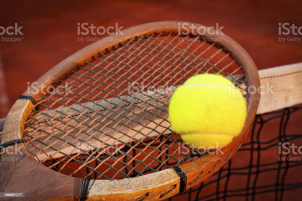 Old wooden tennis racket with ball royalty-free stock photo