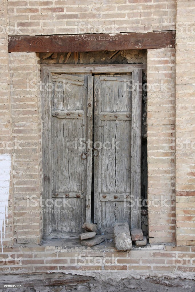 old wooden tumbledown door in the Central Asian style, Bukhara stock photo