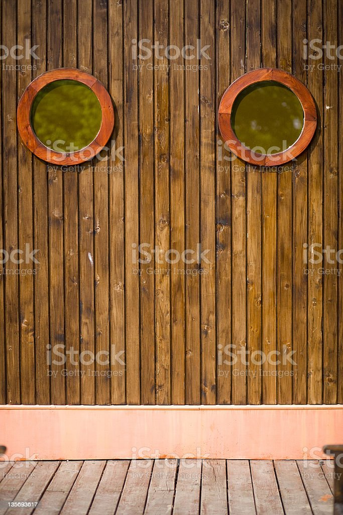 Old wooden wall with portholes stock photo