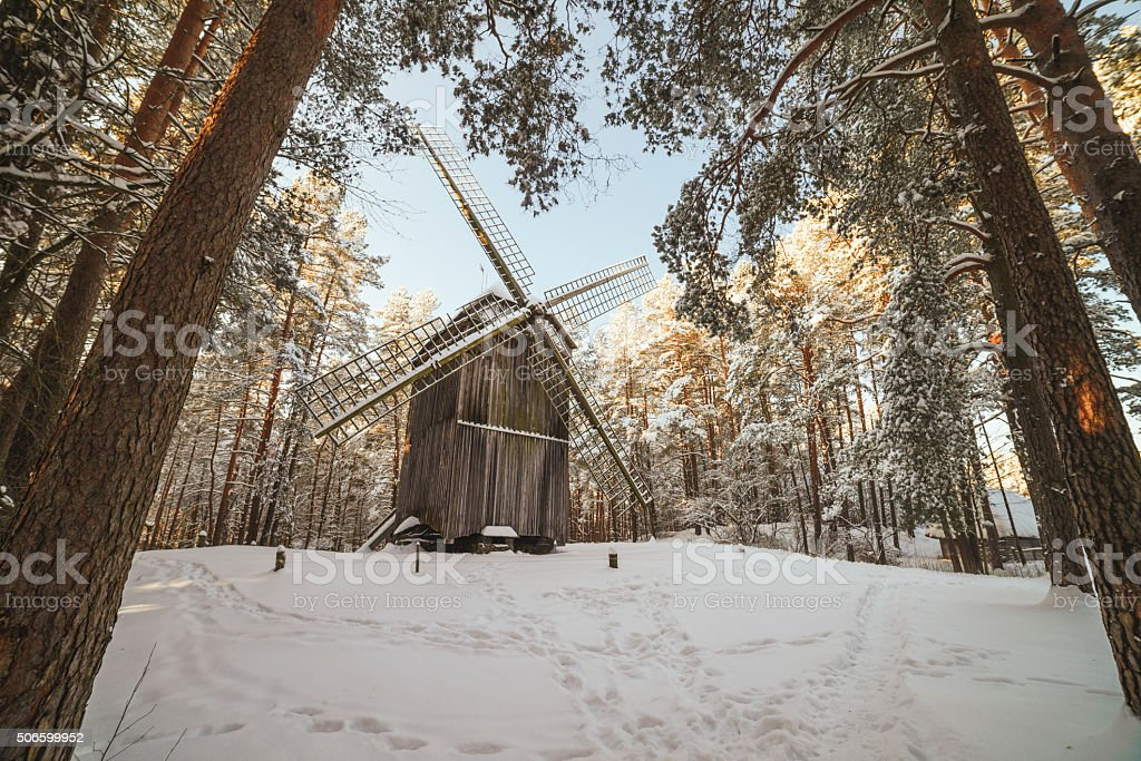 Old wooden windmill stock photo
