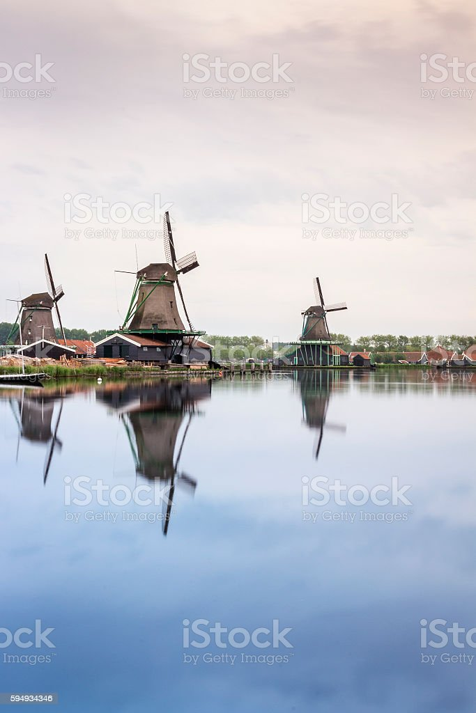 Old, wooden windmills in The Netherlands stock photo
